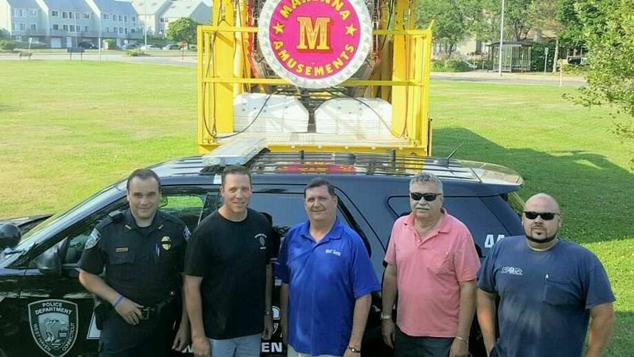 PHOTO CONTRIBUTED BY DAVID O'BRIEN From left, West Haven Police Department Detective Robert Fazzino, vice president of the police union; Detective Sean Faughnan, union president; Mayor Ed O'Brien, George Marenna Jr. and George Marenna III.