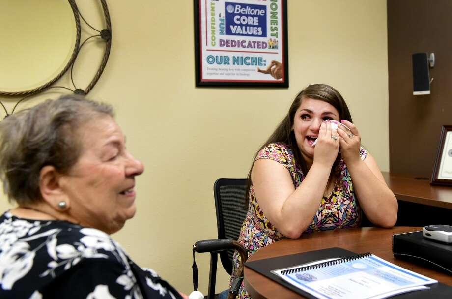 (Peter Hvizdak - New Haven Register)Loretta D'Aniello, 91, of West Haven, left, after being fitted for a Beltone BTE hearing aid , and D'Aniello's granddaughter Melissa D'Aniello, right, cry together during an emotional moment after Loretta realizes she can her clearly after receiving her hearing aids at the Beltone Hearing Center in Orange Tuesday, July 26, 2016.