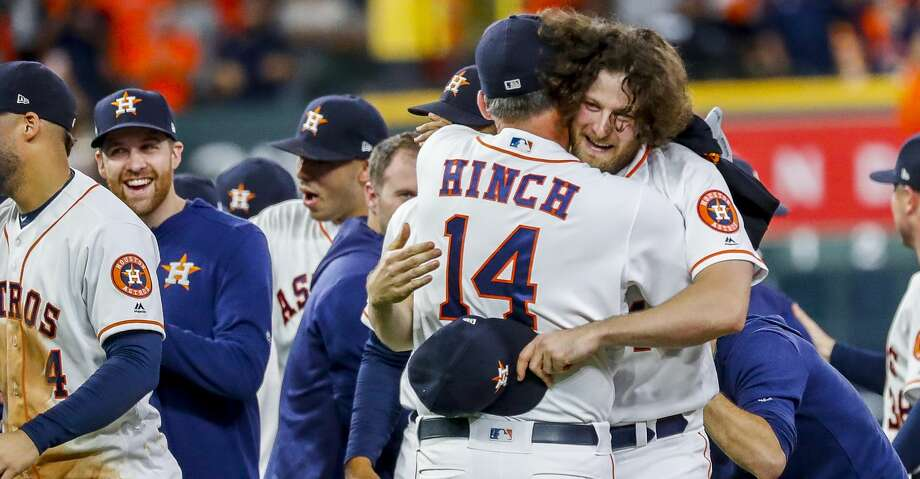 Houston Astros starting pitcher Gerrit Cole (45) hugs manager AJ Hinch (14) after the team wins Game 5 of the American League Division Series at Minute Maid Park in Houston, on Thursday, Oct. 10, 2019. Photo: Karen Warren/Staff Photographer