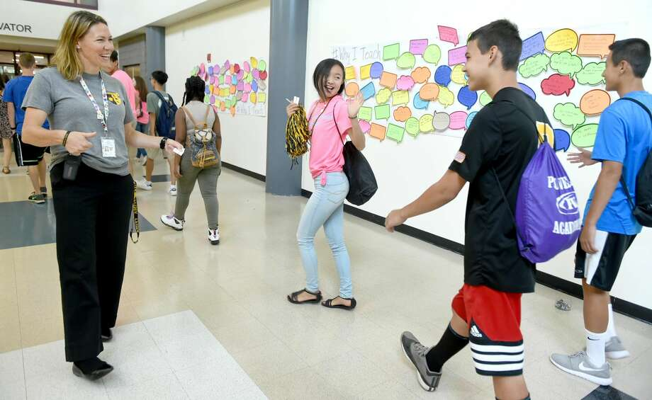 "(Peter Hvizdak - New Haven Register)Amity Regional High School principal Anna Mahon welcomes students in the hallway during a first day of school orientation day used for building community, school morale and inspiration using the slogan ""Making It Happen"" at the school in Woodbridge. Freshman had their orientation to the school with the help of juniors and senior guides. The days' inspirational programming had notable Amity High School graduates share stories of their experiences after graduating the high school. Those graduates included actor/comedian/writer Nic Novicki ('01), U.S. Army Captain Kristen Griest ('07), a West Point graduate and one of the first two women ever to graduate from the Army's elite Ranger School and the country's first female Army infantry officer, and activist Leslie Barrett ('10), co-founder of BARE (Beauty Advocates with Realistic Expectations)."