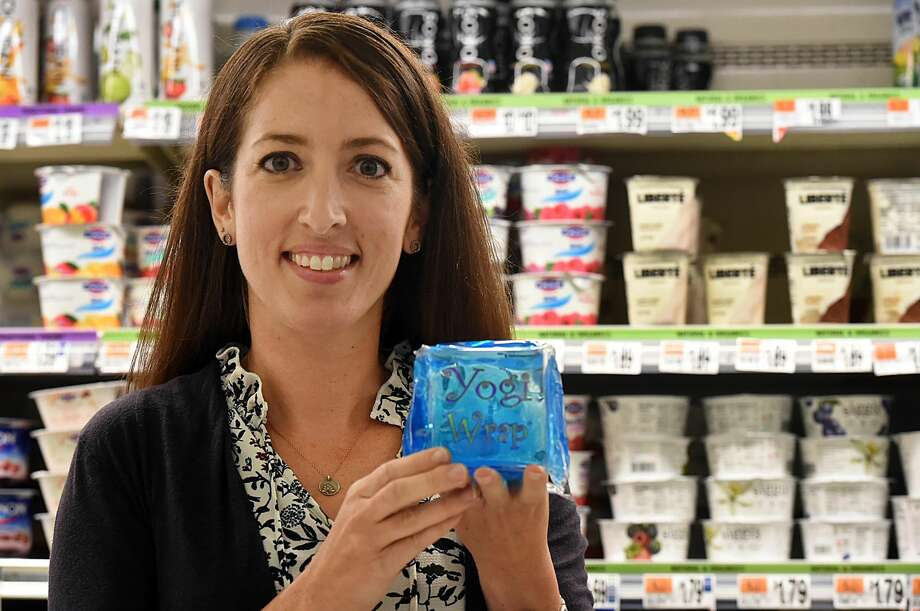 Fourth-grade teacher and mother of two Teri Alves, of Orange, is photographed in a local grocery store with her invention, the Yogi Wrap Sept. 27, 2016. Alves, who survived the Sandy Hook shooting, used her experience as post-traumatic growth to invent the lunchbox-sized yogurt ice pack. (Catherine Avalone/New Haven Register)