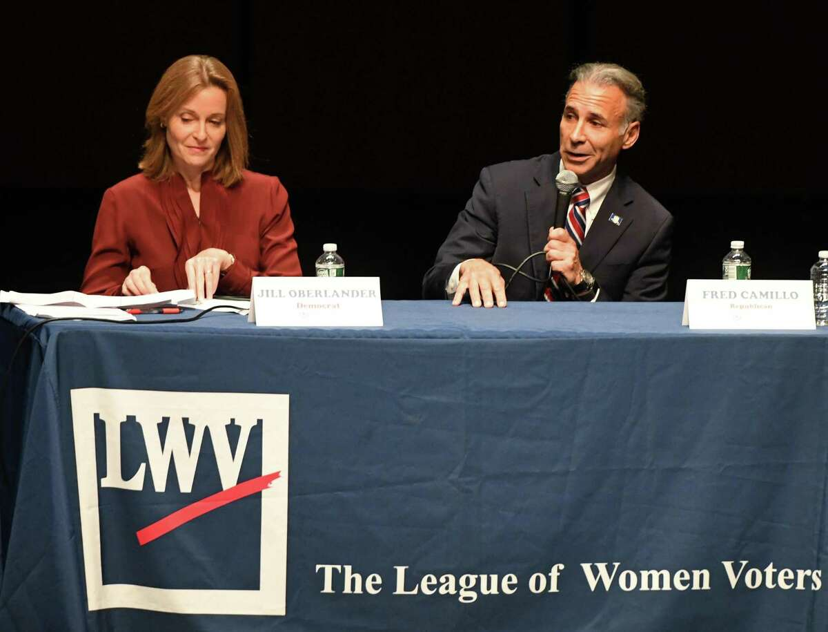Democrat Jill Oberlander and Republican Fred Camillo square off in the League of Women Voters of Greenwich debate for the Board of Selectmen at Greenwich High School in Greenwich, Conn. Thursday, Oct. 10, 2019.