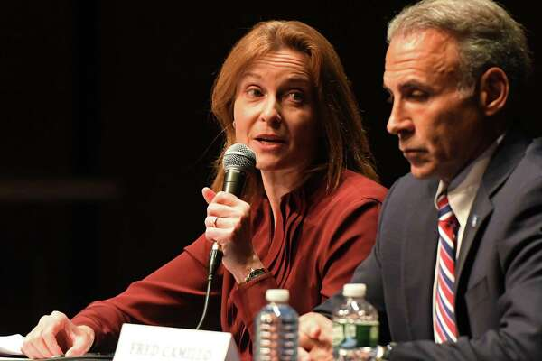 Democrat Jill Oberlander speaks beside Republican Fred Camillo at the League of Women Voters of Greenwich debate last week. An edited video of the exchange between the two over long-term financing is causing some campaign sparks to fly.