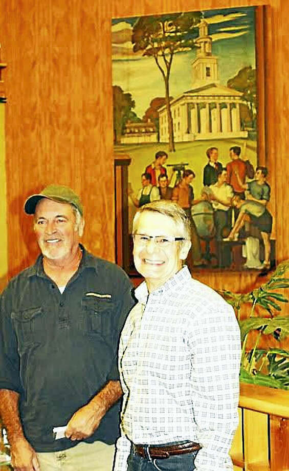 CONTRIBUTED PHOTO William Meddick, former executive director of the Milford Arts Council, and Frank Vespi, former arts coordinator for the Milford Board of Education pause in front of the mural they rescued.