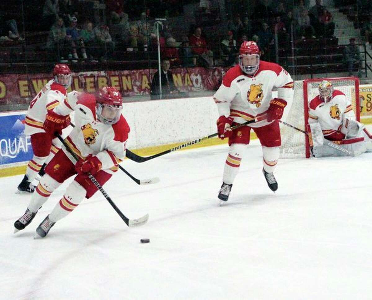 Ferris State'sJake Transit corrals the puck and looks to advance up the ice during Thursday night's game against Colgate at the Ewigleben Ice Arena. (Pioneer photo/Joe Judd)