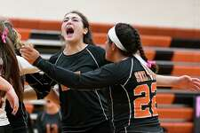 Shelton's Elizabeth Casinelli and Jess Jayakar (22) celebrate after win over Cheshire. Volleyball action between Shelton High and Cheshire High at Shelton High school, Thursday, Oct. 10, 2019