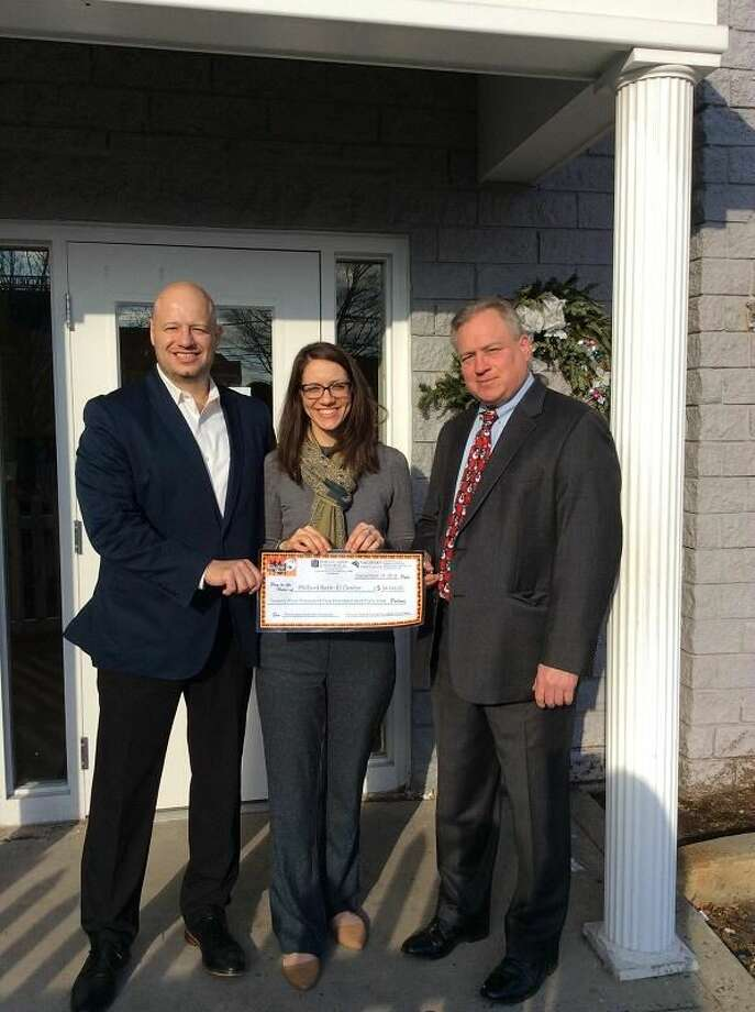 Beth-El Executive Director Jenn Paradis, center, is presented with a check from Ken Ferrari, SVP Chief Retail Officer of Sikorsky Credit Union and Attorney Joseph Kubic of Harlow, Adams & Friedman.