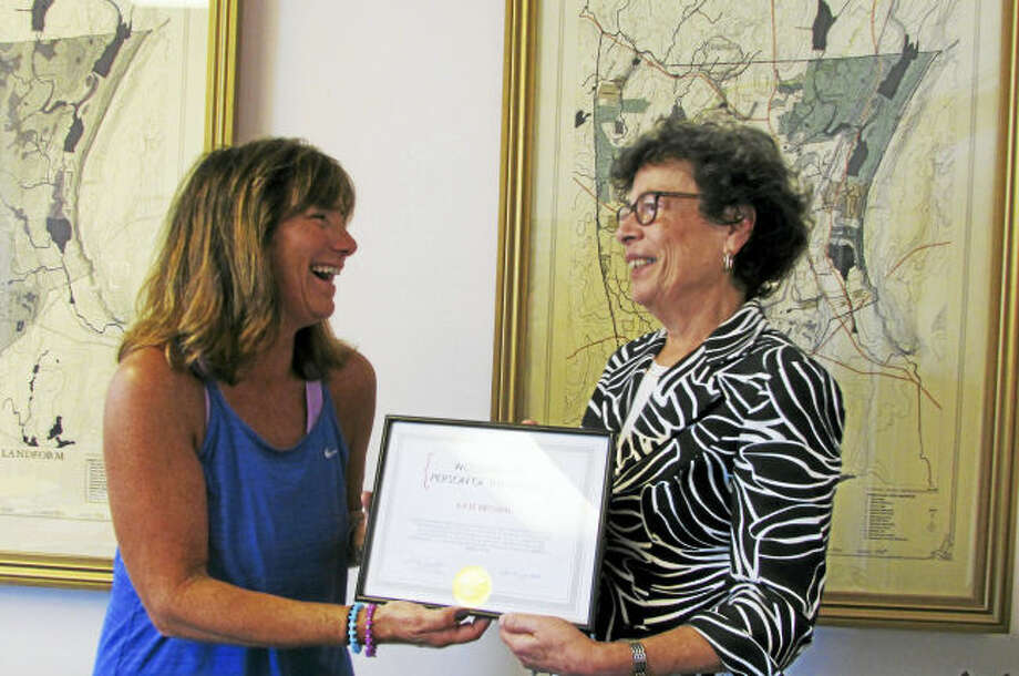 First Selectman Ellen Scalettar, right, recognizes Kate Brown as the October Woodbridge Person of the Month for October.