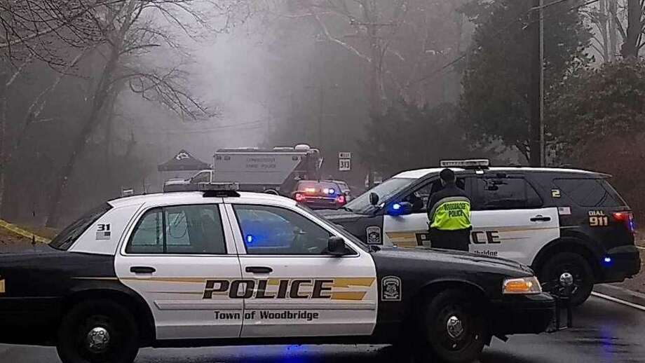 Woodbridge police block Rimmon Road during homicide investigation in April 2018.