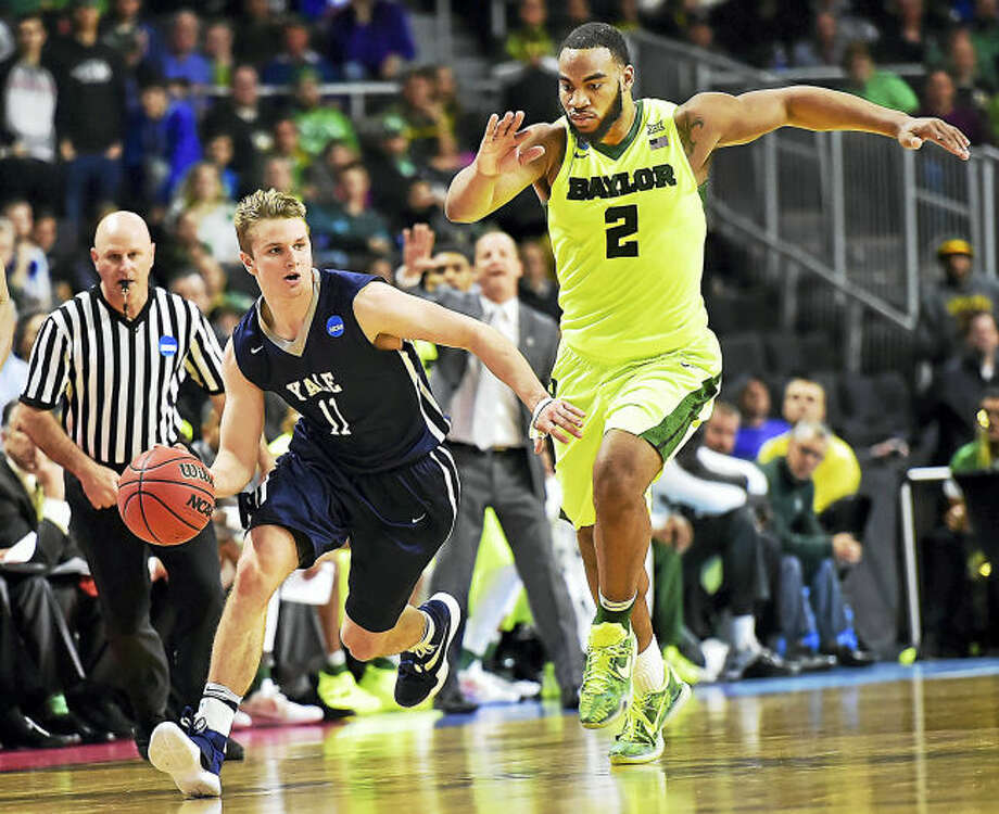Yale's Makai Mason takes off on a fastbreak as Baylor's Rico Gathers defends in the final seconds of a 79-75 victory for the Bulldogs in the first round of the 2016 NCAA Men's Basketball Tournament at the Dunkin' Donuts Center in Providence, RI. (Catherine Avalone/New Haven Register)