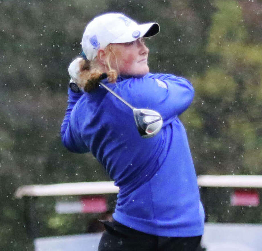 Marquette's Gracie Piar watches her drive in the on hole No. 2 on Thursday morning in the Class 1A girls golf regional at Spencer T. Olin in Alton. Piar was medalist with a 76. Photo: Greg Shashack / The Telegraph