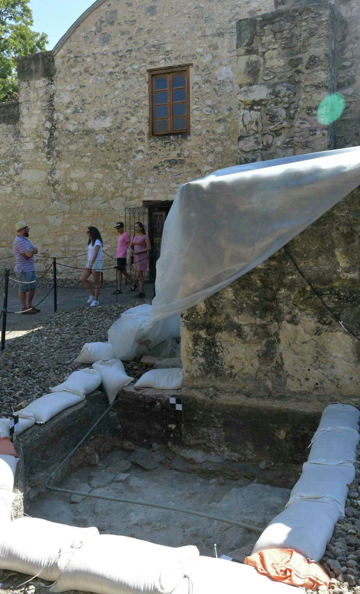 Tourists leave the Alamo, near an archaeological dig which contains what appears to be the foundation of a watchtower on Thursday, Oct. 10, 2019. The tower is shown on two historic maps drawn by Edward Everett, one dating to 1846 and the second dating to 1848.