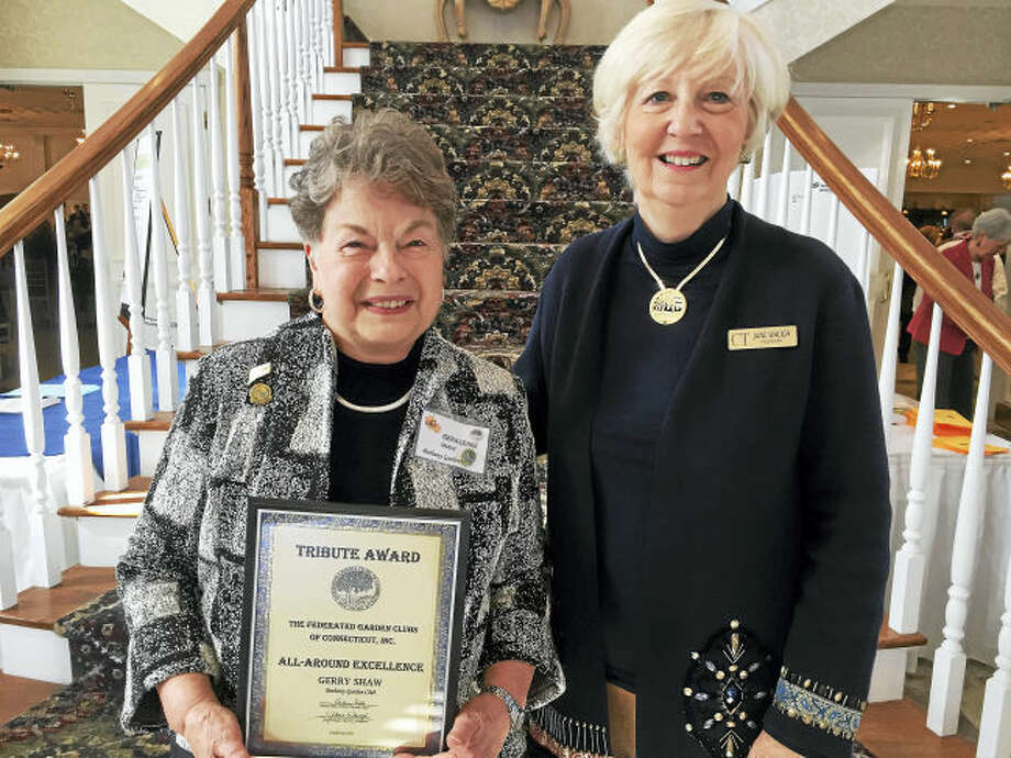 Gerry Shaw of the Bethany Garden Club, left, receives the Tribute Award for All-Around Excellence from Jane Waugh, president of the Federated Garden Clubs of Connecticut. Shaw helped found the club 50 years ago.