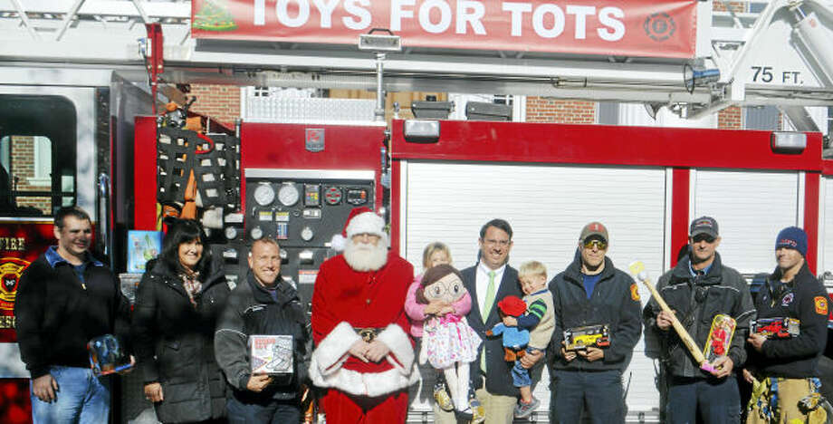 Milford firefighters joined Santa and Mayor Benjamin G. Blake at City Hall to kick off the 2016 Toys for Tots. New, unwrapped toys, books or games can be brought to any fire station, the city clerk's office or Durham School Services until Dec. 16 Checks may be mailed to Toys for Tots, Station 7, 55 Wheeler's Farms Road, Milford 06461. The program, sponsored by Milford Professional Firefighters Association, Local 944, supports more than 300 city families annually.