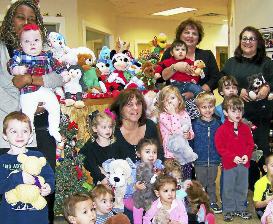 Students at Holly Hill Childcare pose with infant teachers Paula Curry, left, Sue Puhl, Assistant Director Debbie Fedorko and preschool teacher Kristie Labacz.