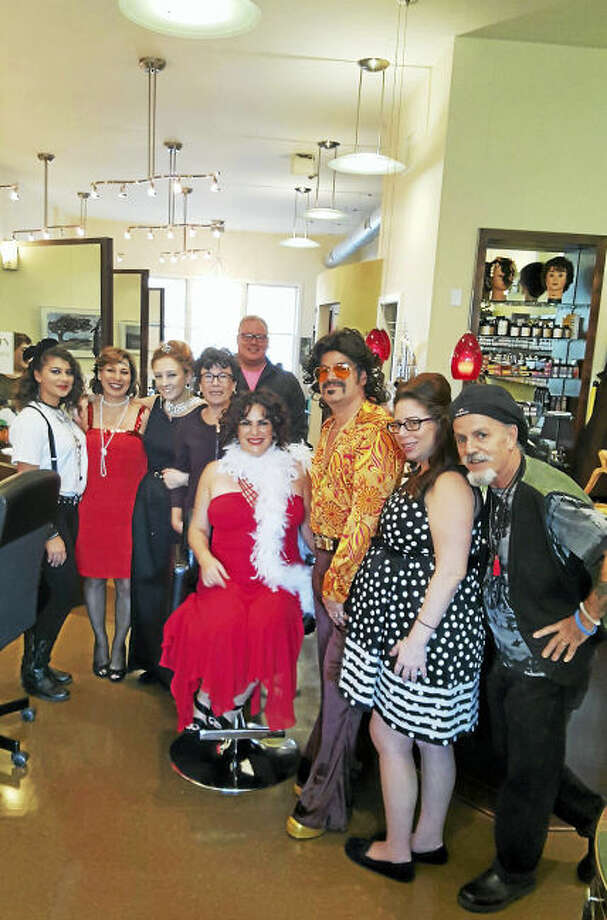 From left, Progressions Salon & Wig Boutique's staff members Haley Conway, Jean Demayo and Kourtney Hargaray; Woodbridge First Selectman Ellen Scalettar, Victor Ranero; co-owner Stephanie Cabral, Keith Proto, Jennifer Adelman and co-owner Mario Cabral. Not pictured are staff members Diane Kline and Tracy Daniels.