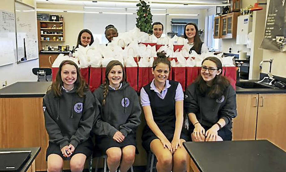 Students from Lauralton Hall, Milford, assembled and delivered 40 gift bags of personal care products, along with five large boxes of replacement items, to the Mercy Learning Center in Bridgeport on Dec. 15. From left, in back, Christiana Cottrell, Ann Papin, Erin O'Connell and Emily Bump; in front, Francesca Norko, Angelina Debenedet, Emma Jacobs and Kathryn Blanco.