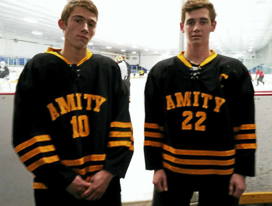 The Amity hockey team, including Nick DeGennaro, left, and Mac Deane will be playing exhibition games in Germany this week.