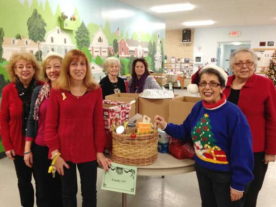 Submitted Photo Woodbridge Human Services staff organize holiday baskets for Woodbridge families in need.