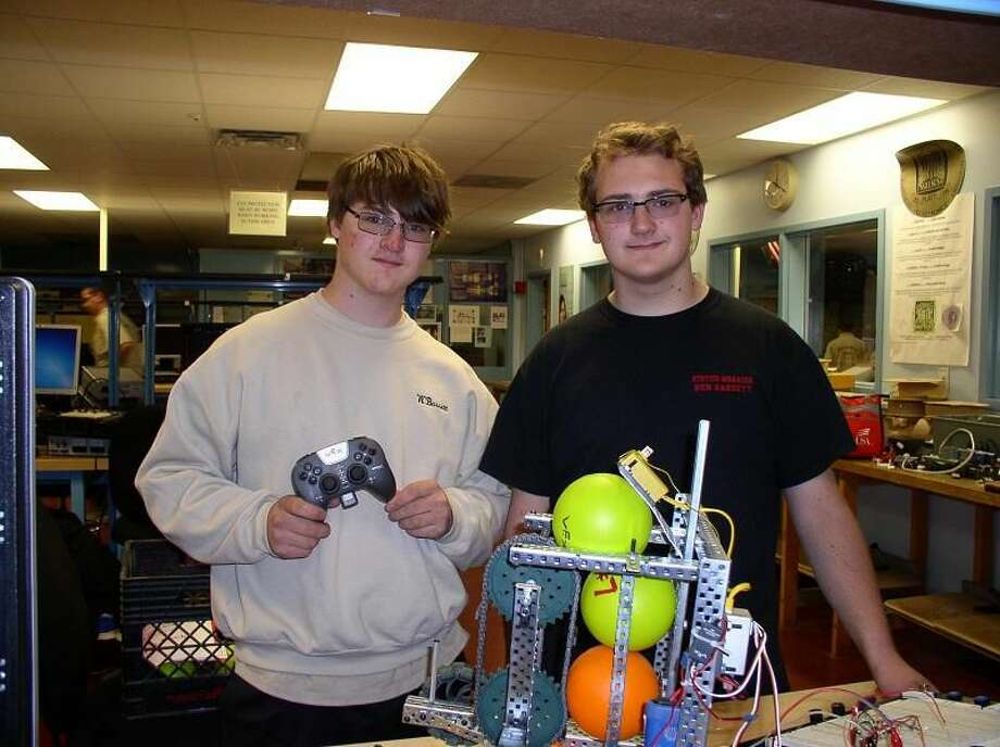 CONTRIBUTED PHOTO William Bassett, left, and his brother, Ben, won first place in Connecticut for their robot in the SkillsUSA competition and hope to move on to the national competition in June, along with another nine winners. The Platt students are trying to raise $10,000 for the trip.