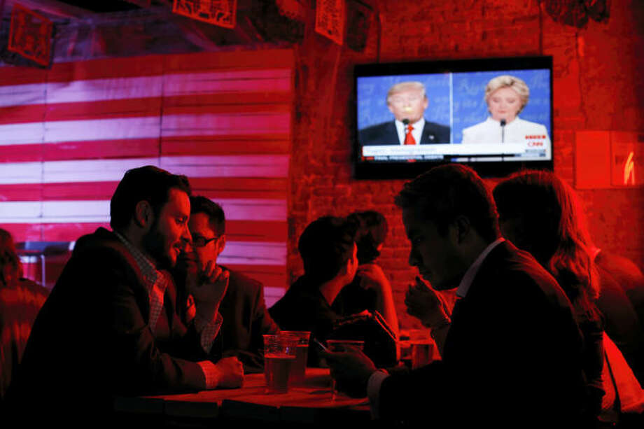 Customers watch the third and last U.S. presidential debate at the Pinche Gringo BBQ restaurant in Mexico City Wednesday.