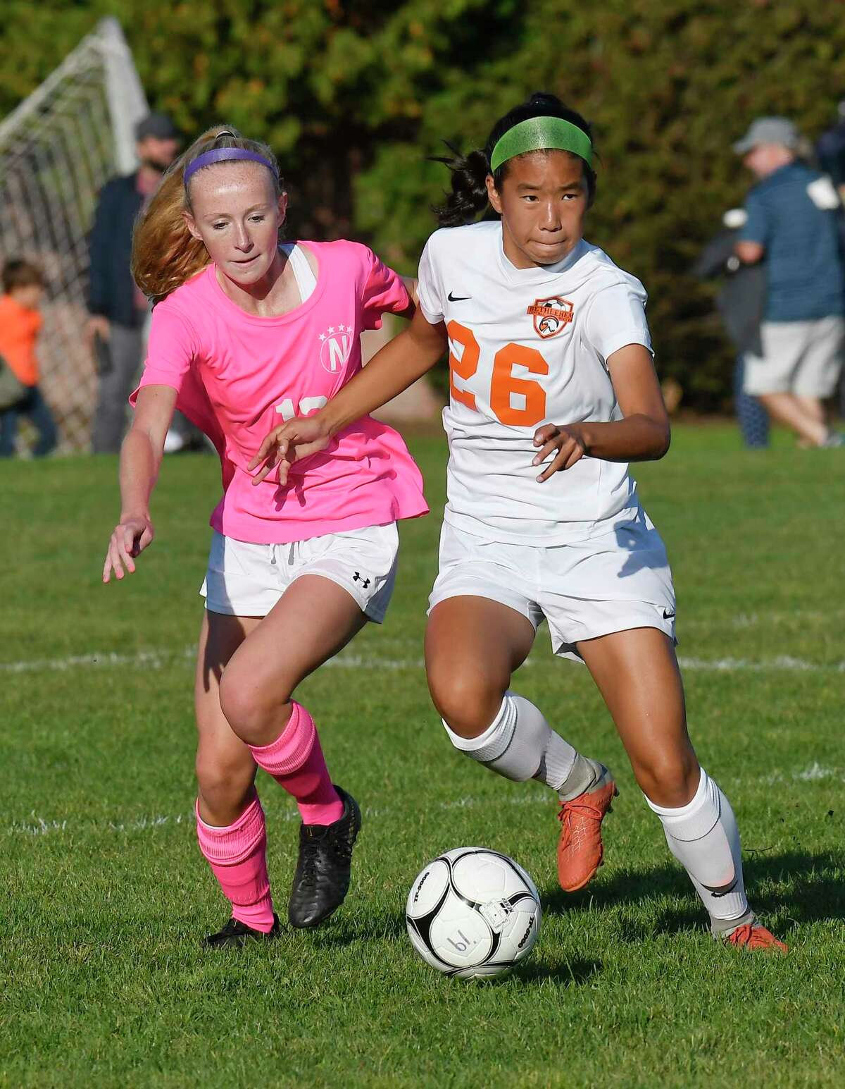 Niskayuna's Addiie Zimmerman( 13 and Bethlehem's Marissa Mastracco battle for control of the ball during a girls' Section II high school soccer game in Niskayuna, N.Y., Thursday, Oct. 10, 2019. (Hans Pennink / Special to the Times Union)