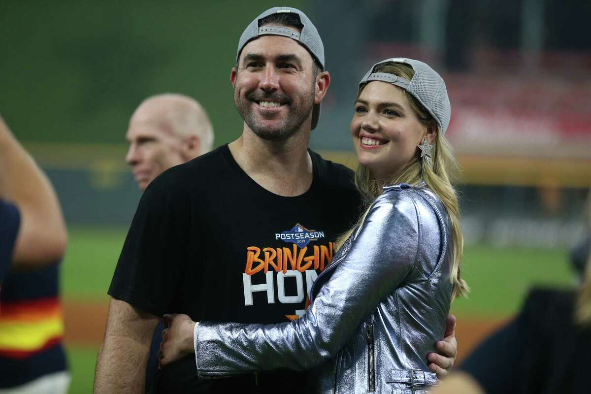 HOUSTON, TEXAS - OCTOBER 10: Justin Verlander #35 of the Houston Astros and Kate Upton celebrate the 6-1 win over the Tampa Bay Rayst in game five of the American League Division Series at Minute Maid Park on October 10, 2019 in Houston, Texas.