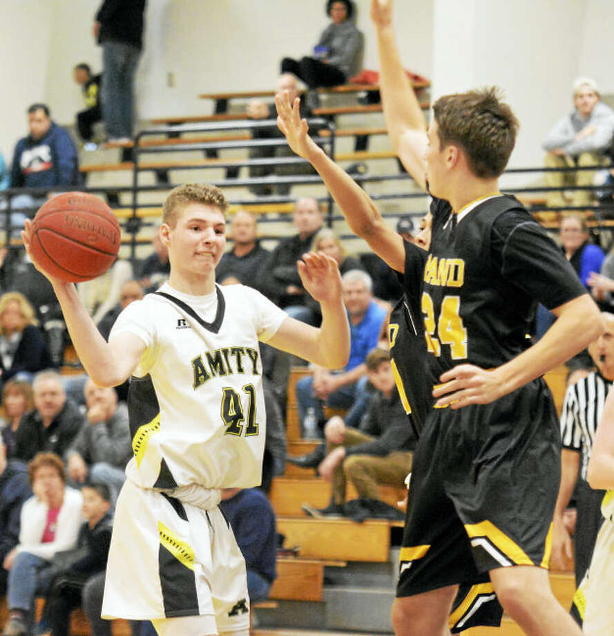 Amity's James van Hise looks for an open man as Hand's Flynn Driscoll defends.