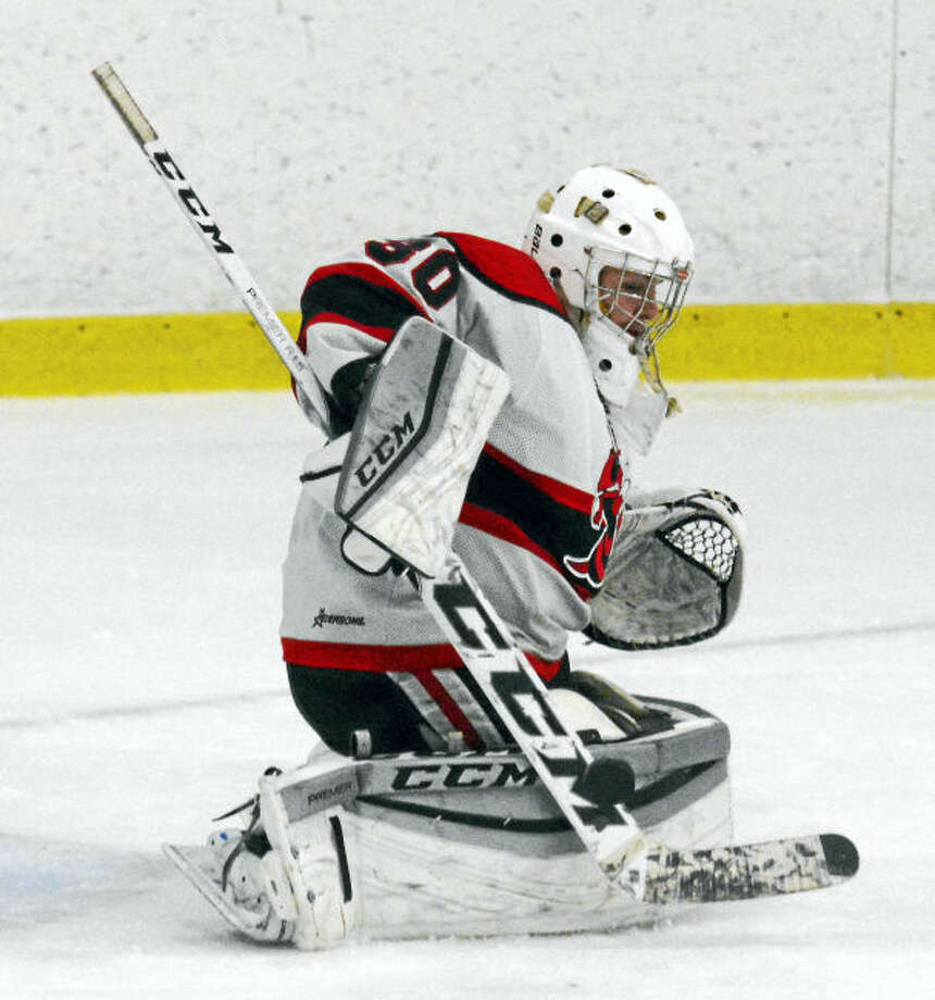 Branford goalie Justin Edwards steers a shot aside in Branford's win over Milford.