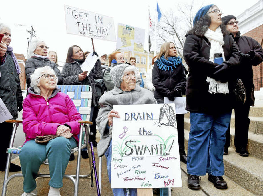 (Arnold Gold-New Haven Register) Mary Mullins (seated left), 95, and Mary Volanth (seated center), 94, of Milford attend a protest in front of Milford City Hall during the inauguration of President Donald Trump on 1/20/2017. Volanth first vote in a presidential election was for President Franklin Roosevelt in his last term and has voted in every election since.
