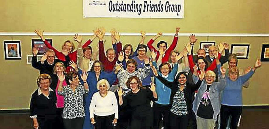 Volunteers cheer at the news that the Friends of the Milford Library was named the 2016 Outstanding Friends Group by the Friends of the Connecticut Libraries.