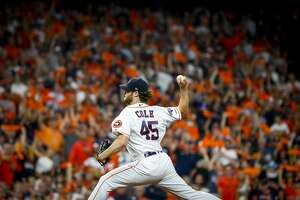 Houston Astros starting pitcher Gerrit Cole (45) pitches during the fifth inning of Game 5 of the American League Division Series at Minute Maid Park in Houston, on Thursday, Oct. 10, 2019.