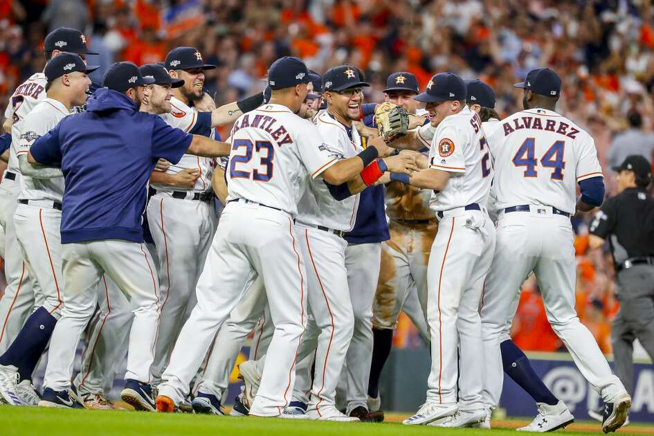 The Houston Astros celebrate on the field as they win Game 5 of the American League Division Series at Minute Maid Park in Houston, on Thursday, Oct. 10, 2019.