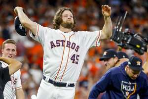 Houston Astros starting pitcher Gerrit Cole (45) celebrates as the Astros win Game 5 of the American League Division Series at Minute Maid Park in Houston, on Thursday, Oct. 10, 2019.
