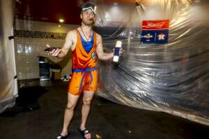 Houston Astros right fielder Josh Reddick (22) celebrates the Astros win of Game 5 of the American League Division Series at Minute Maid Park in Houston, on Thursday, Oct. 10, 2019.