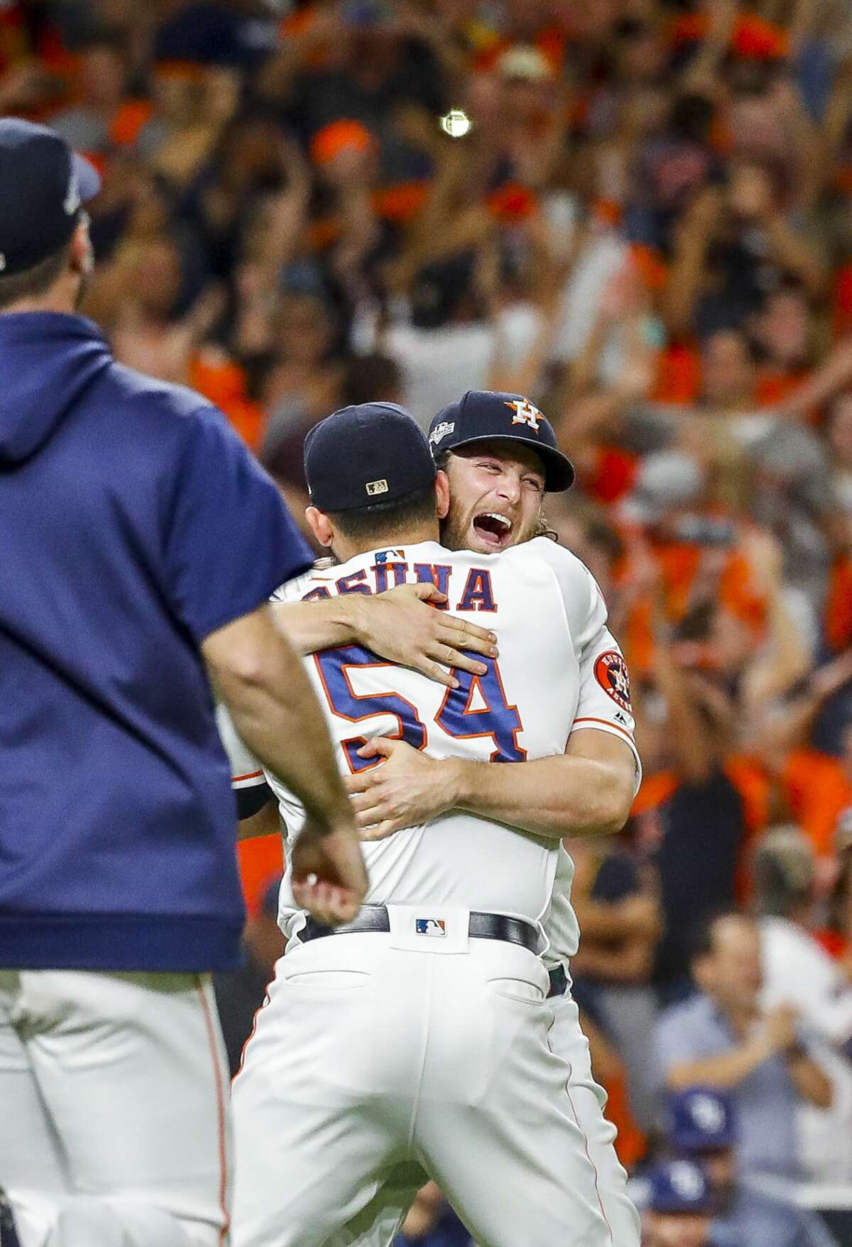 Houston Astros starting pitcher Gerrit Cole (45) hugs relief pitcher Roberto Osuna (54) as the Astros win Game 5 of the American League Division Series at Minute Maid Park in Houston, on Thursday, Oct. 10, 2019.
