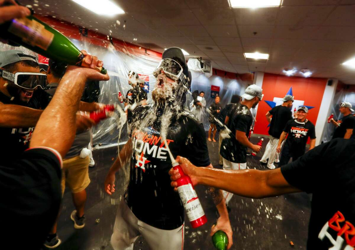 Astros pitcher Chris Devenski is doused with alcohol while celebrating the Astros win in Game 5 of the American League Division Series at Minute Maid Park in Houston, on Thursday, Oct. 10, 2019.