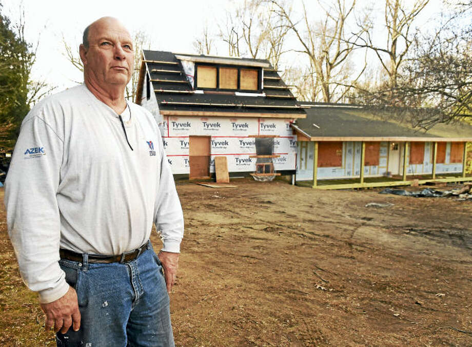 Peter Whaley is trying to rehabilitate this house in Shelton after a series of circumstances that has drained him financially. At the same time his wife became ill, their daughter, with two children, became a widow.