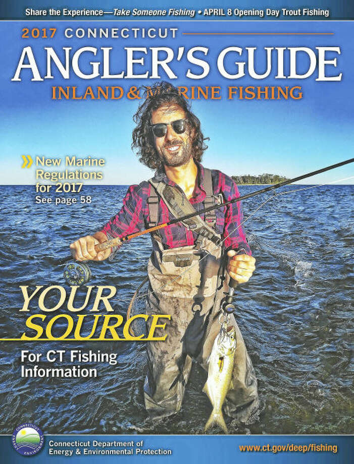 The 2017 Connecticut Angler's Guide Photo Contest winner Derek Angel of Avon holds a bluefish caught fly-fishing the dropping tide at the Charles Island tombolo, Silver Sands State Park, Milford.