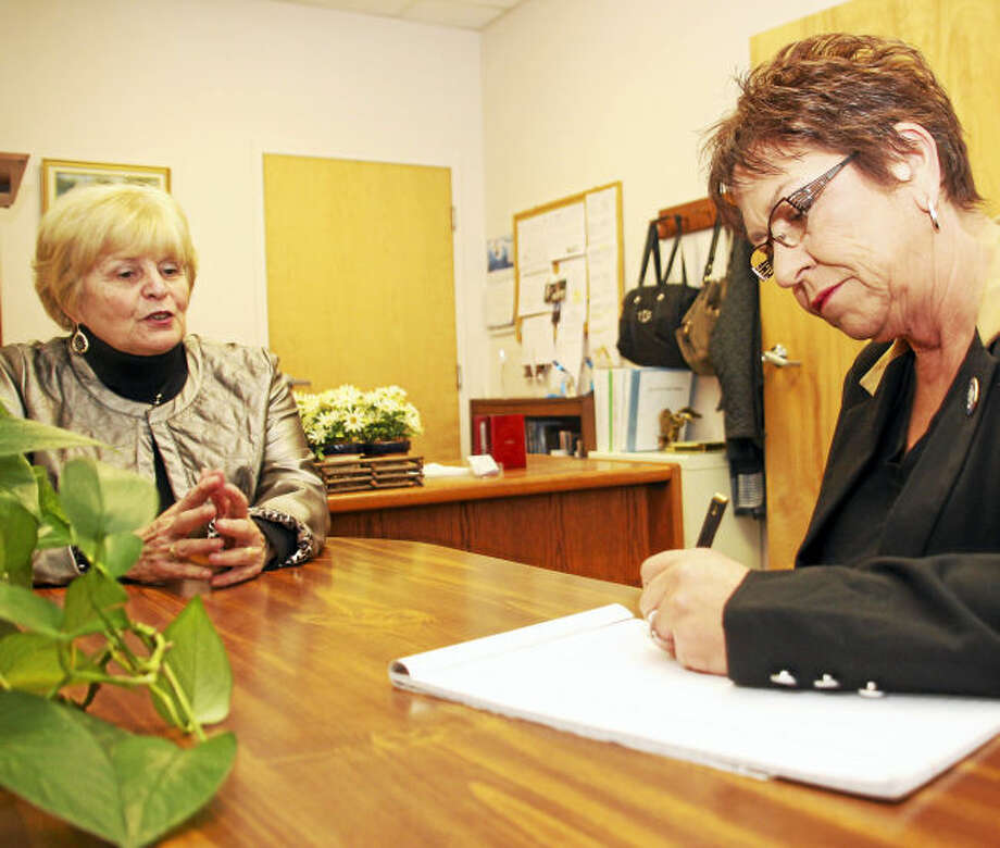 Toni Dolan, left, and state Rep. Kim Rose meet.