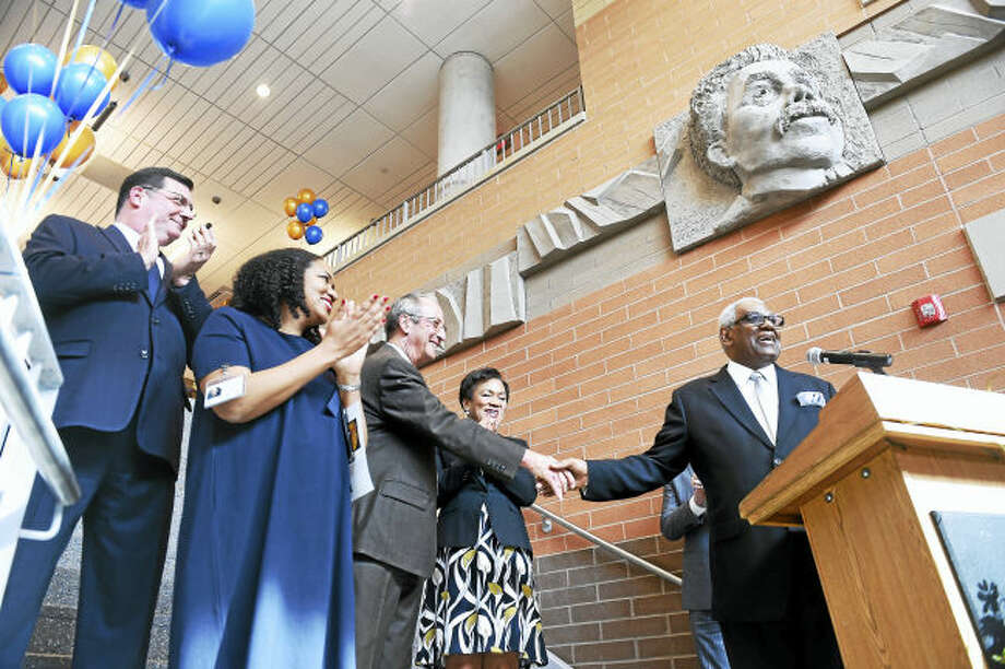(Arnold Gold-New Haven Register) University of New Haven President Steve Kaplan (center) shakes the hand of New Haven Public Schools Superintendent Reginald Mayo (right) before the ribbon cutting ceremony in the lobby of the Engineering and Science University Magnet School in West Haven on 2/28/2017. Left to right are West Haven Mayor Ed O'Brien, ESUMS Principal Medria Blue-Ellis, University of New Haven President Steve Kaplan, New Haven Mayor Toni Harp and New Haven Public Schools Superintendent Reginald Mayo.