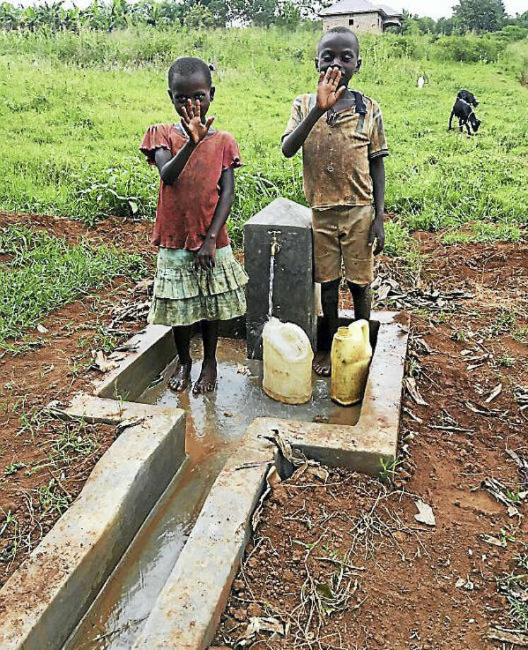 Children collect water at one of several pumps in Nganiko, Uganda.