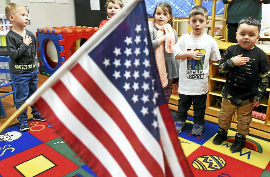 Orange Congregational Church Nursery School class of 4- and 5-year-olds recites the Pledge Of Allegiance Wednesday morning, March 1, 2017. The church nursery school is celebrating its 50th anniversary.