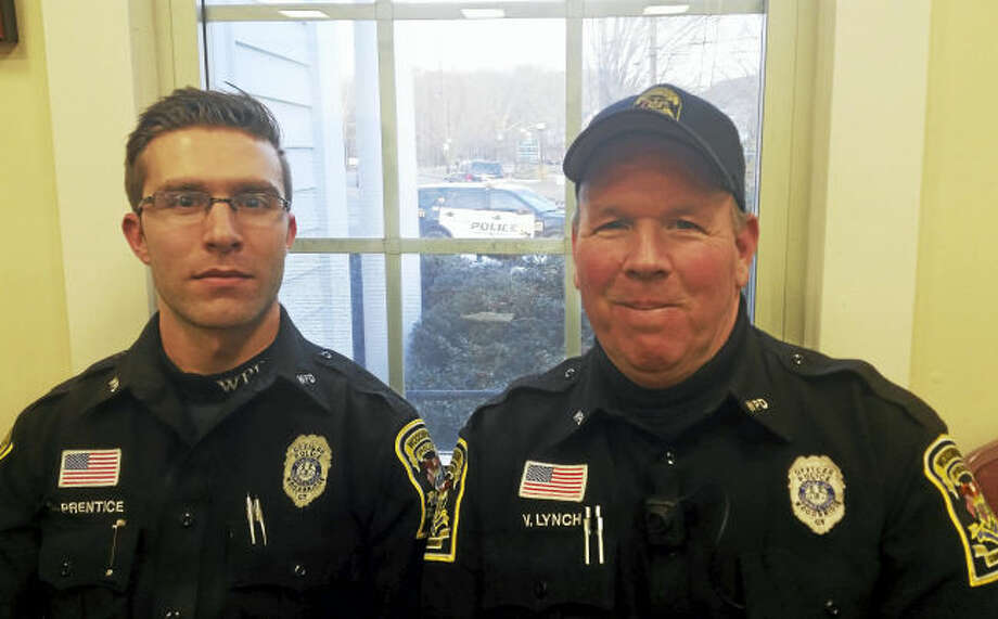 Amity school resource officer Scott Prentice, left, and Beecher Road School resource officer Vincent Lynch at a recent special meeting of the Woodbridge Board of Police Commissioners.