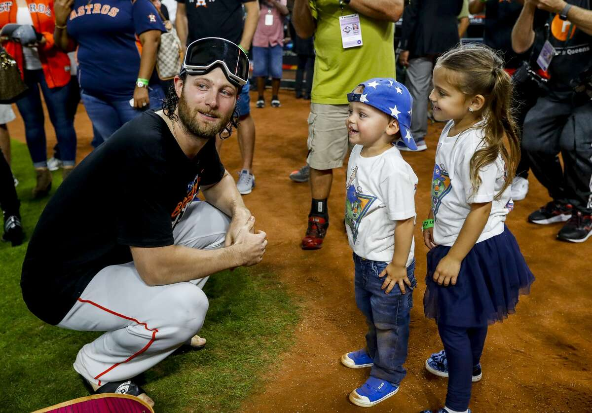 Houston Astros starting pitcher Gerrit Cole (45) talks with his niece and nephew following Game 5 of the American League Division Series at Minute Maid Park in Houston, on Thursday, Oct. 10, 2019.