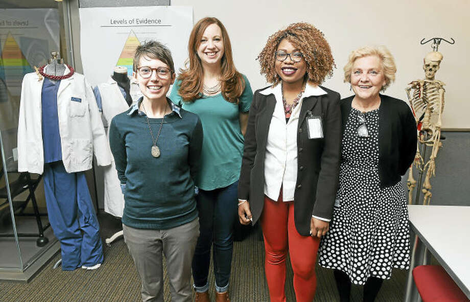 Left to right, Yale School of Nursing students Jessica Kelly-Hauser, Elizabeth Renker and Chimene Diomi with professor Linda Honan at the Yale School of Nursing in Orange.