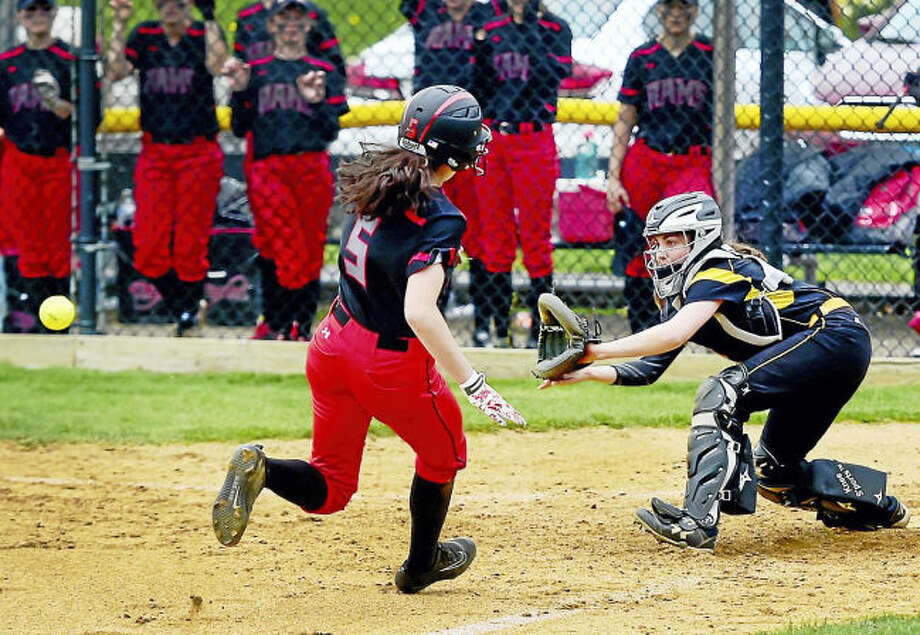 Amity catcher Rachel Crow, right, waits for the ball and blocks home plate before tagging out Cheshire's Lindsay Abramson during the second inning Monday in Woodbridge.