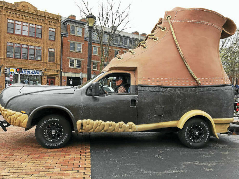 Keith Smith of L.L.Bean backs the bootmobile onto Broadway island in New Haven.