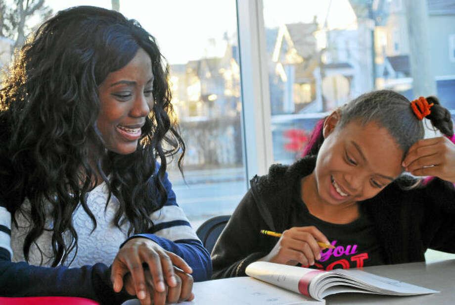 New Haven Reads volunteer tutor Vimbai Ushe and student Bella Gomez-Stafford.