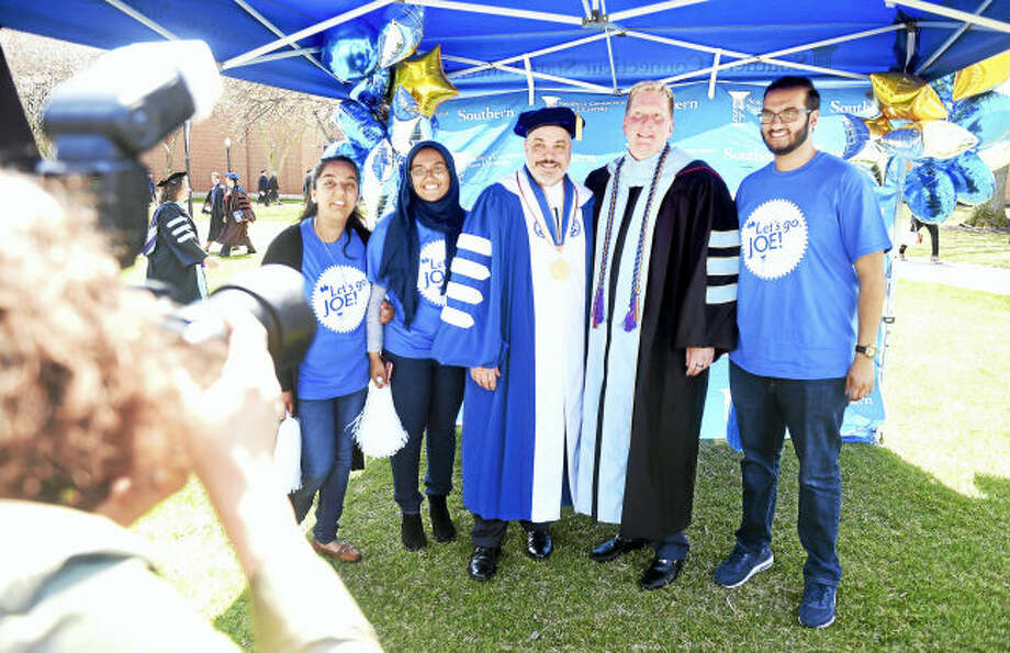 Southern Connecticut State University's 12th president, Joe Bertolino, center, and his partner, Bill Leipold, center right, assistant vice chancellor of human resources at Rutgers University-Newark, are photographed with Southern students, from left, Anam Khan, Sanjida Shamim and Amin Sheikh after inauguration ceremonies for Bertolino Friday.